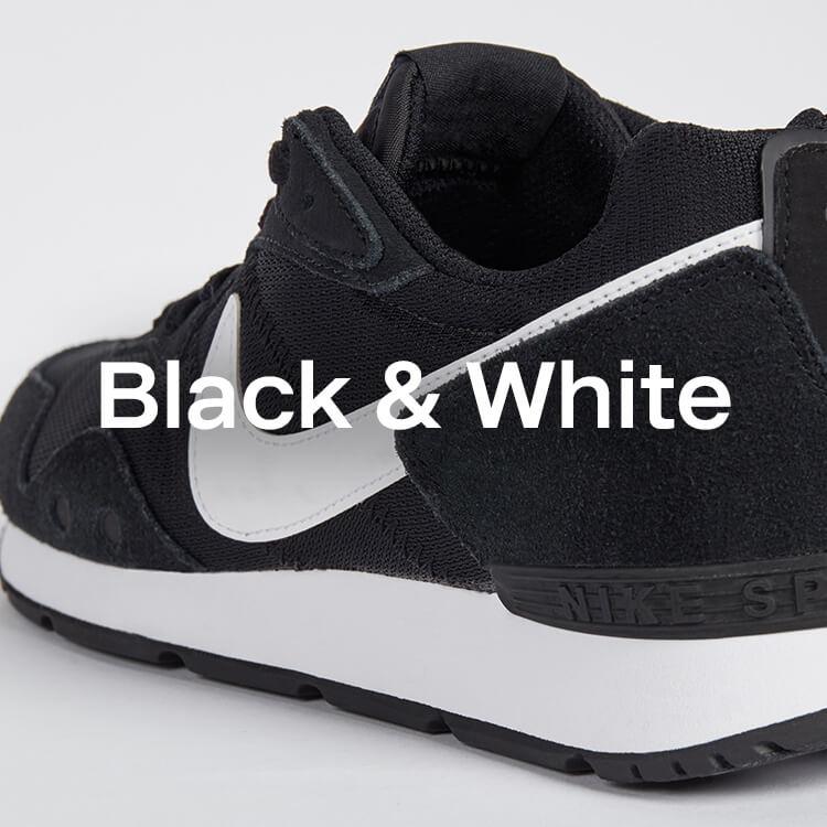 Schwarze und weisse Sneaker von Nike und Reebok